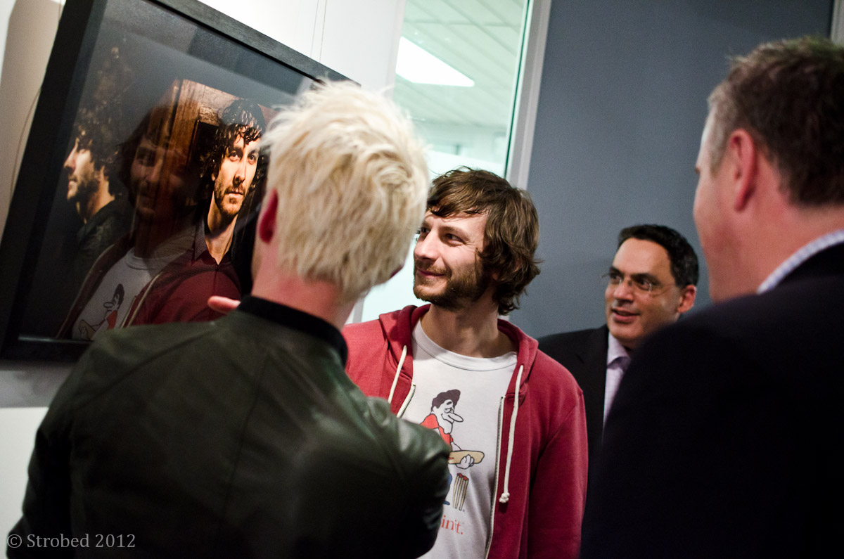Gotye looking at a photo of himself.